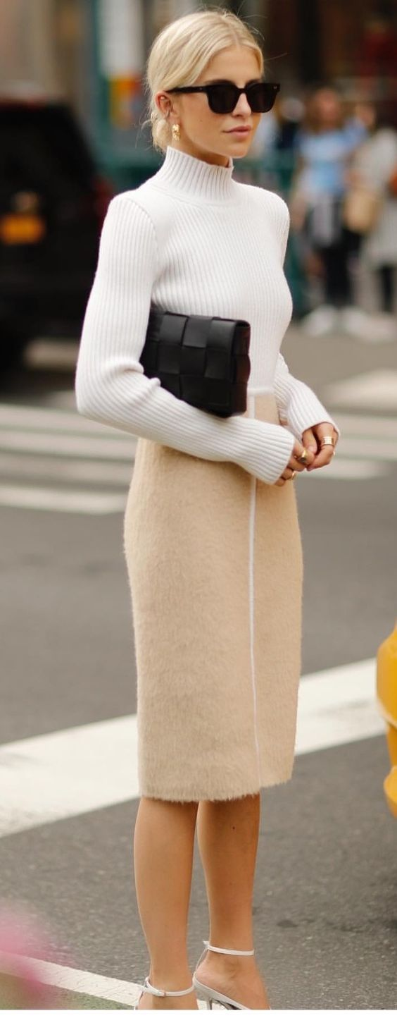 Chic white sweater and beige skirt