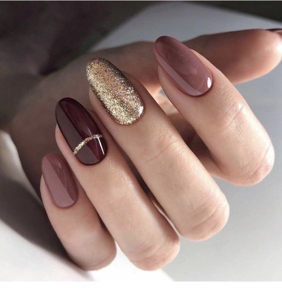 Chic brown gel nails with glitter