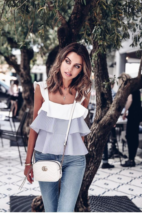 Top with ruffles, jeans and bag