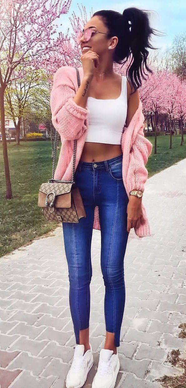 pink cardigan,white crop top, and blue denim fitted jeans #spring #outfits