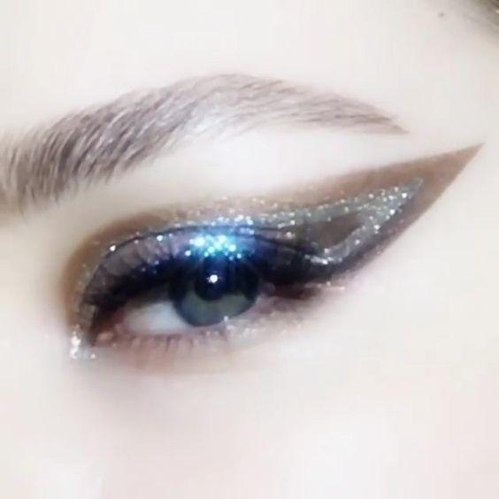 Dramatic winged cat eye makeup using Pat McGrath Labs 'Dark Star 006' Ultrasuede Brown eyeshadow kit | Click through to shop the look! #cateyemakeup #darkstar006 #patmcgrathlabs
