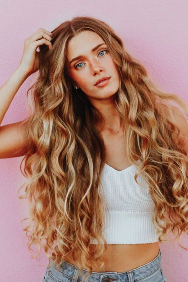 Textured waves! Use a 32mm titanium wand with heat shield, and salt and sea spray for extra texture!