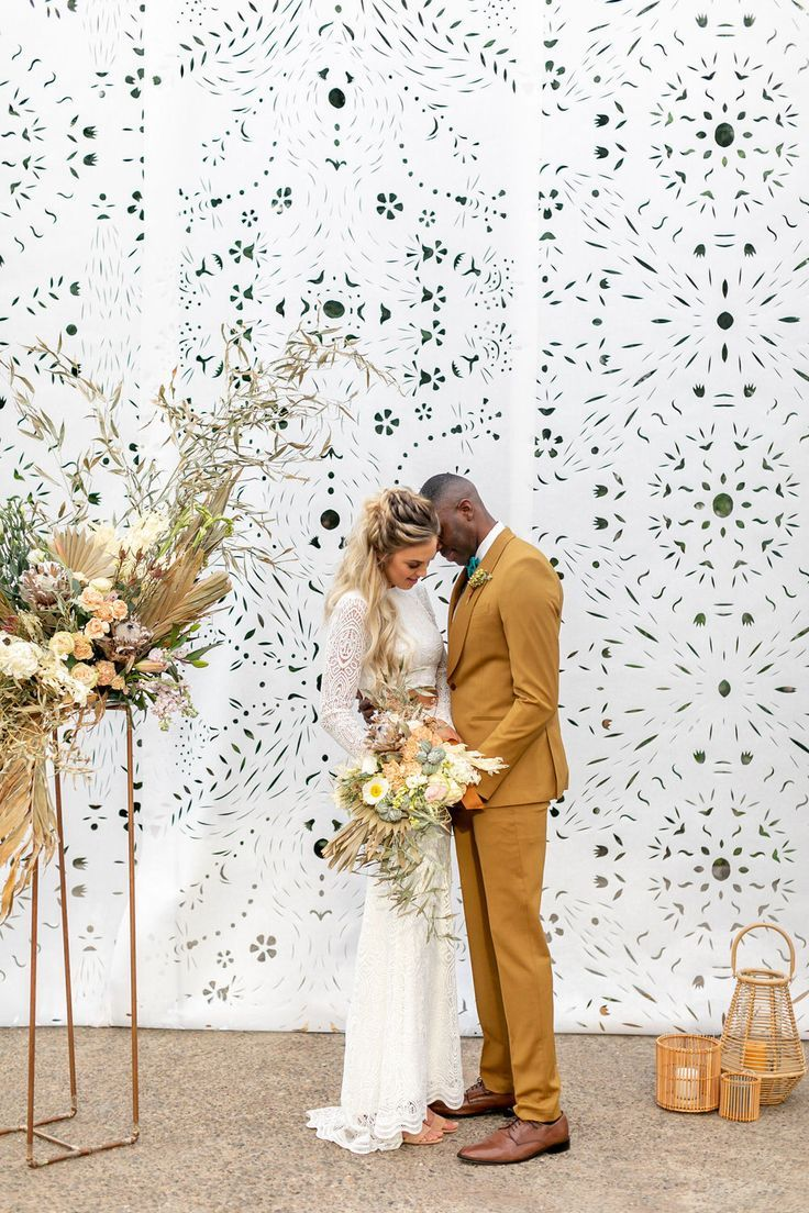 Our modern wedding dreams have come true with this gorgeous styled shoot in Philadelphia. Featuring a massive papel picado backdrop, this modern summer wedding is our new obsession. Can you blame us?