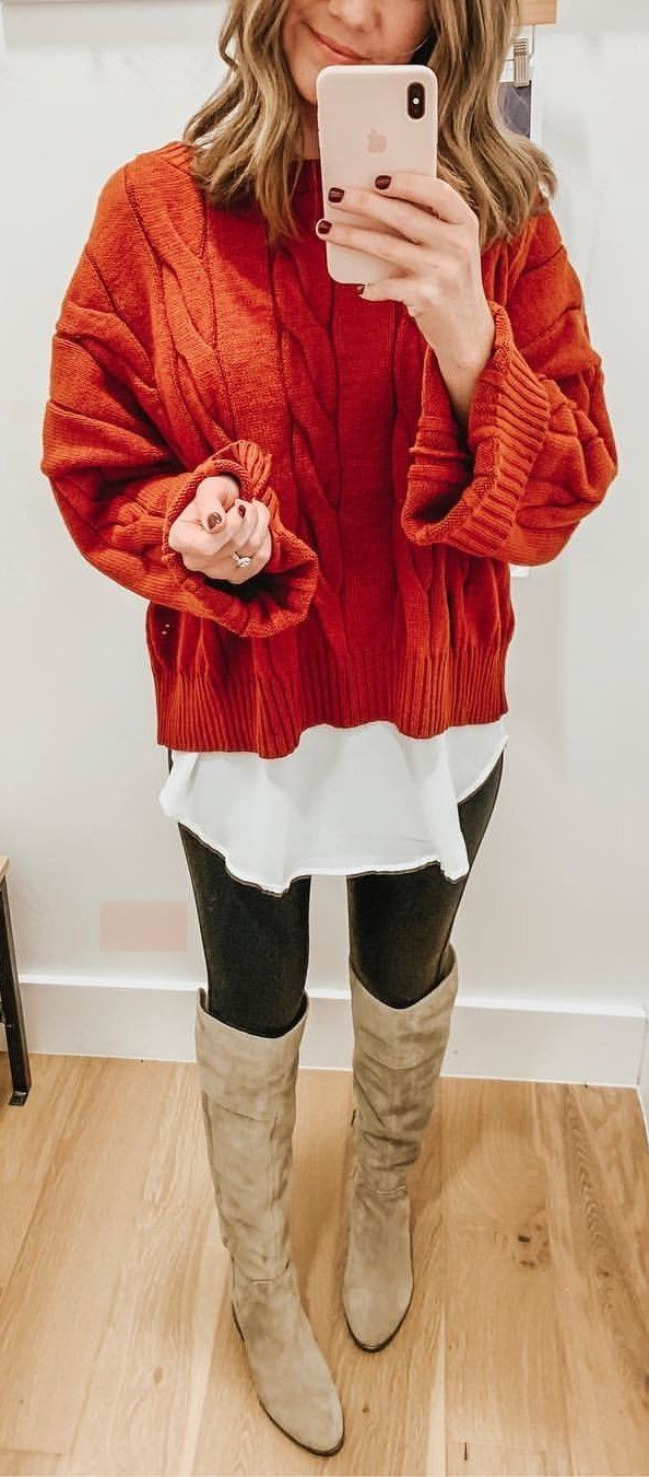 red cable-knit sweater