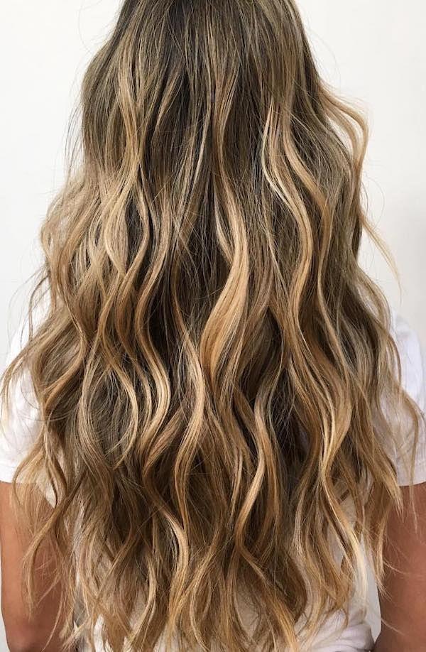 Elegant brown hair dye with caramel highlights