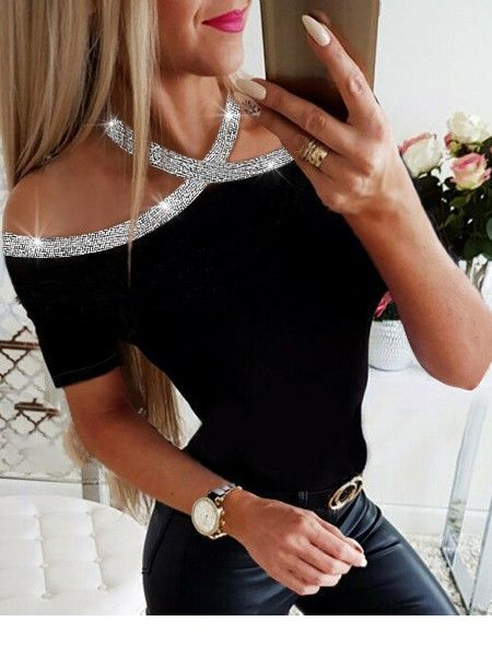 Black top with silver glitter and leather pants