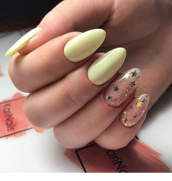 Light yellow nails with stars