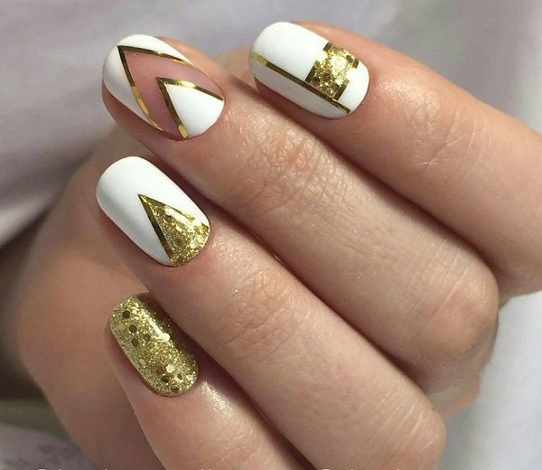 White and Gold Classy Nail Art.White and Gold, ah perfect hue. Well, if you don't agree, see this glittery, sparkly and perfect example of this saying.