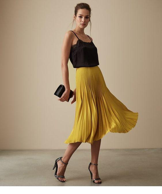 Black top and yellow midi skirt