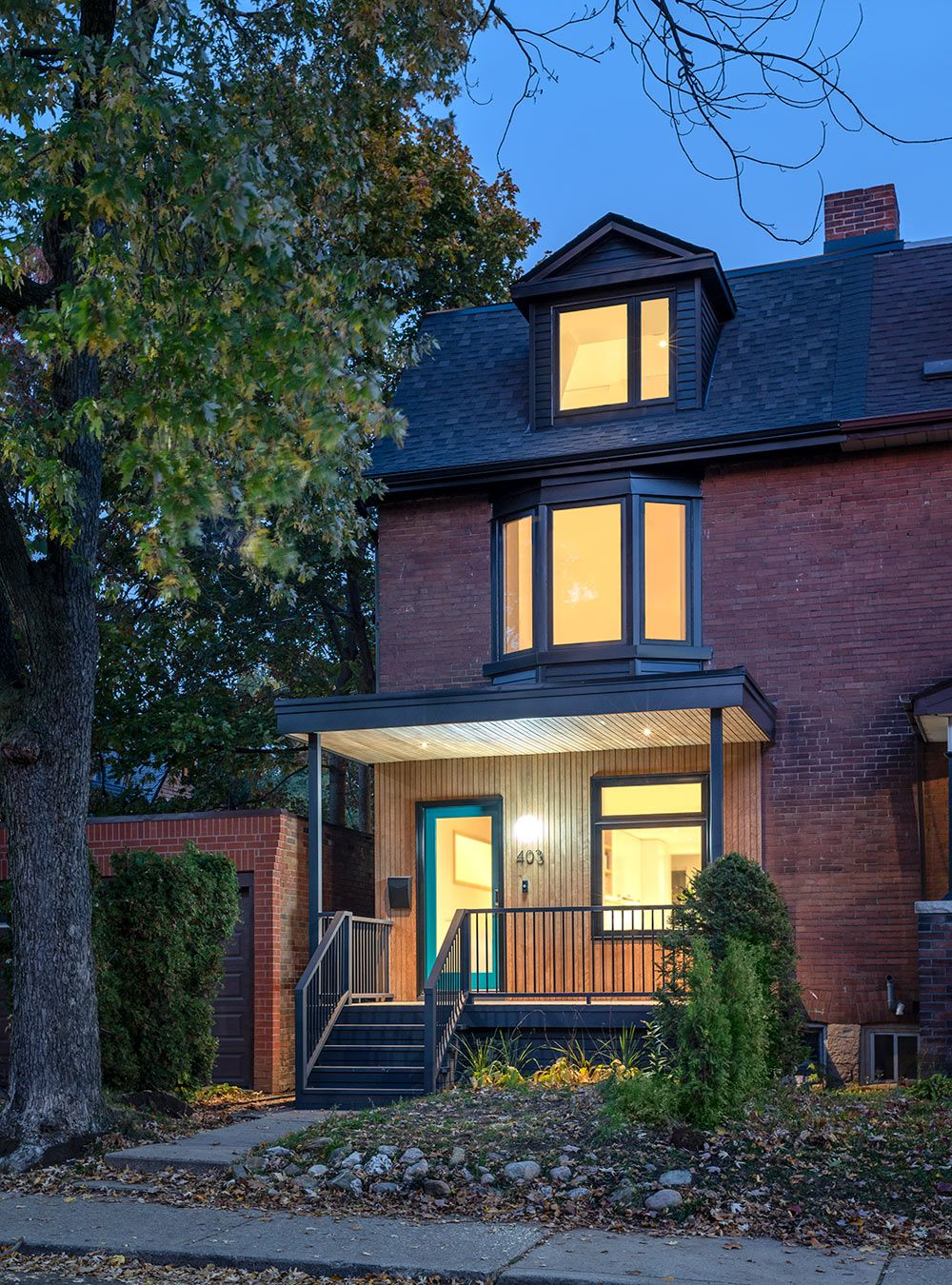 AAmp Studio Renovates and Adds Onto a 100-Year Old Townhouse in Toronto - Design Milk