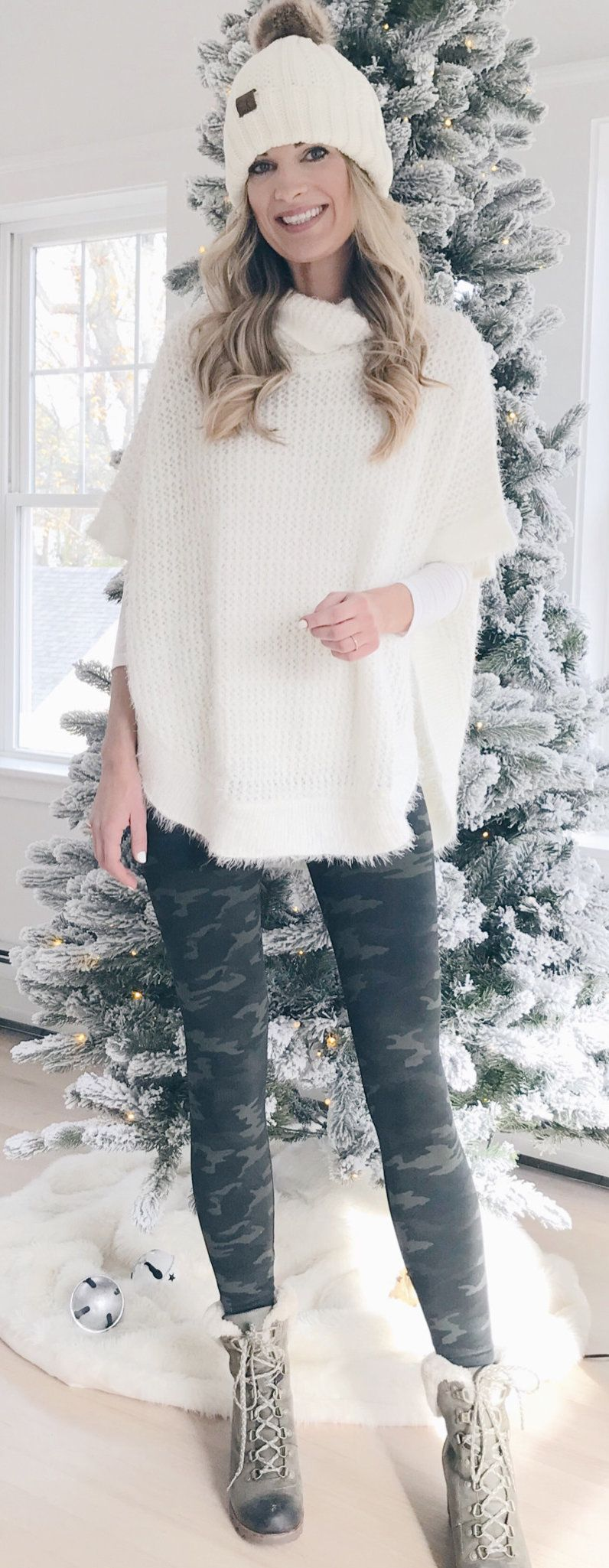 white sweater and black camouflage pants