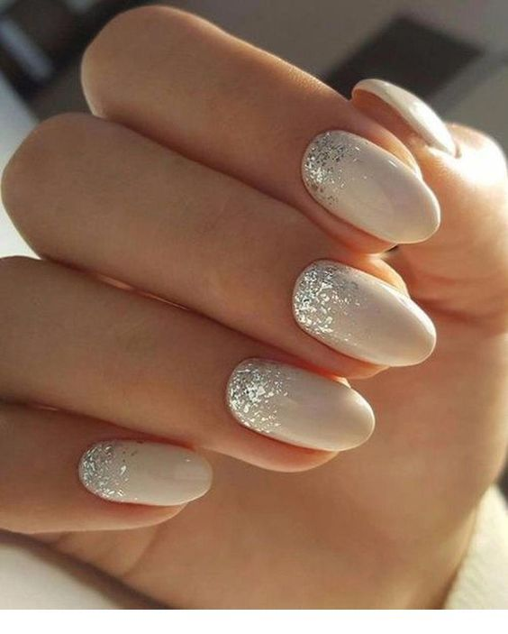 Beige nails with silver glitter