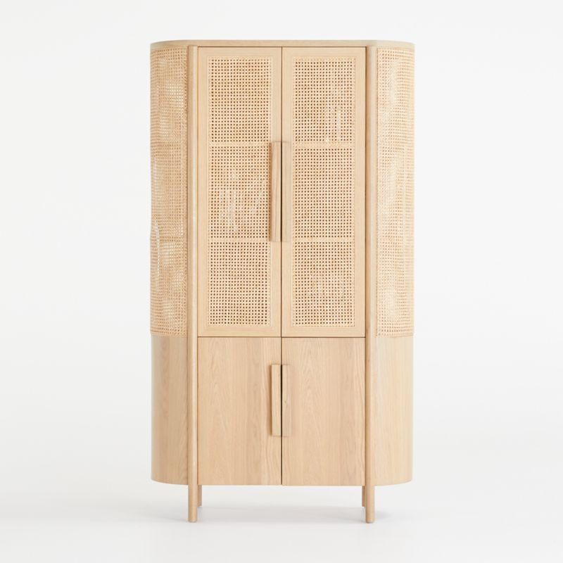 Shop Fields Natural Storage Cabinet. Beautifully grained white oak and retro caning shape the breezy curves of our striking Fields cabinet.