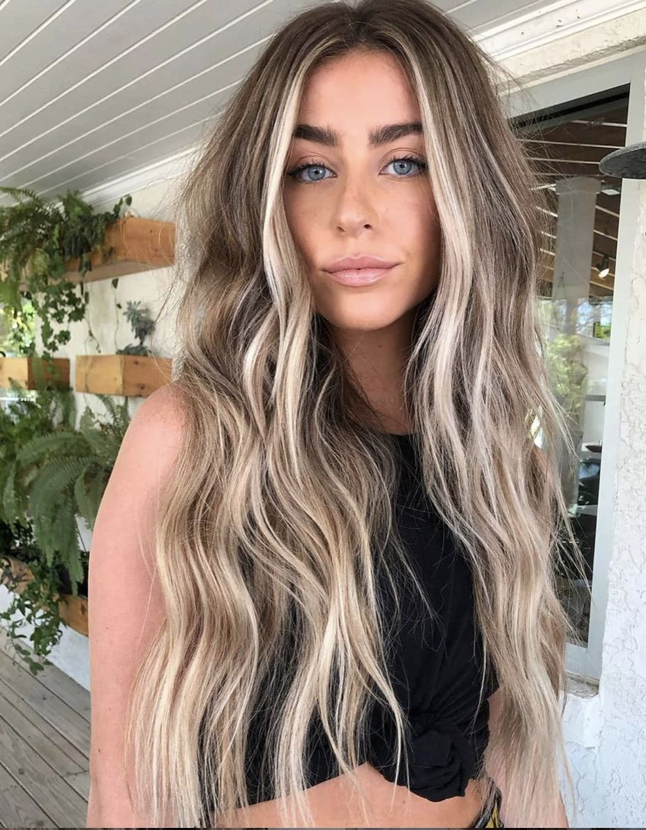 We are in love with these creamy, swirly, vanilla toned blondes and are expecting to see them trending this spring. #blonde #warmblonde #vanillablonde #creamyblonde #behindthechair #springhair #springtrends #hairtrends #balayage #blondebalayage