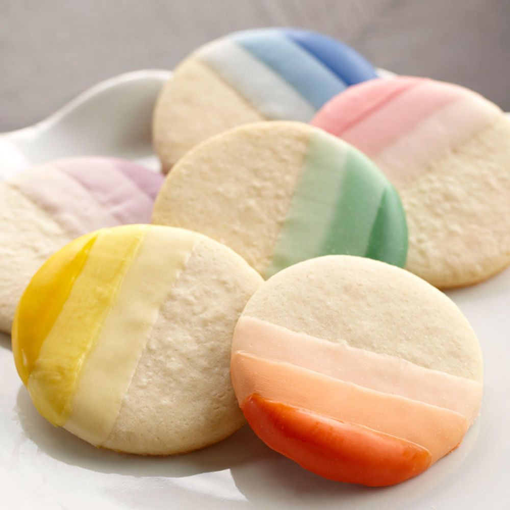 Find great ideas, recipes & all the supplies you'll need at wilton.com including Ombre Candy-Dipped Cookies.