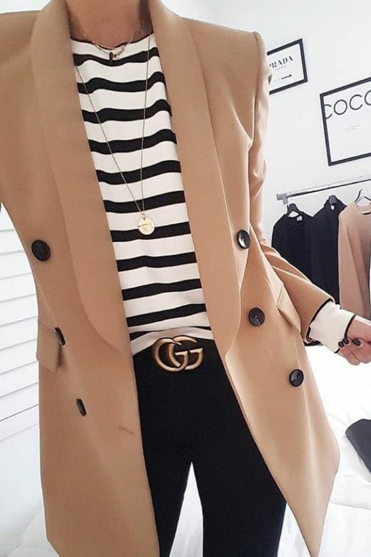 Classic style - camel double breasted jacket, striped tee, dark denim jeans, and a Gucci belt