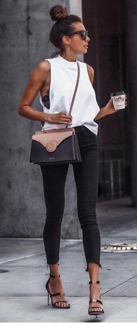 White top and black jeans with a nice bag