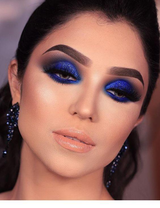 Lovely blue eye makeup and earrings