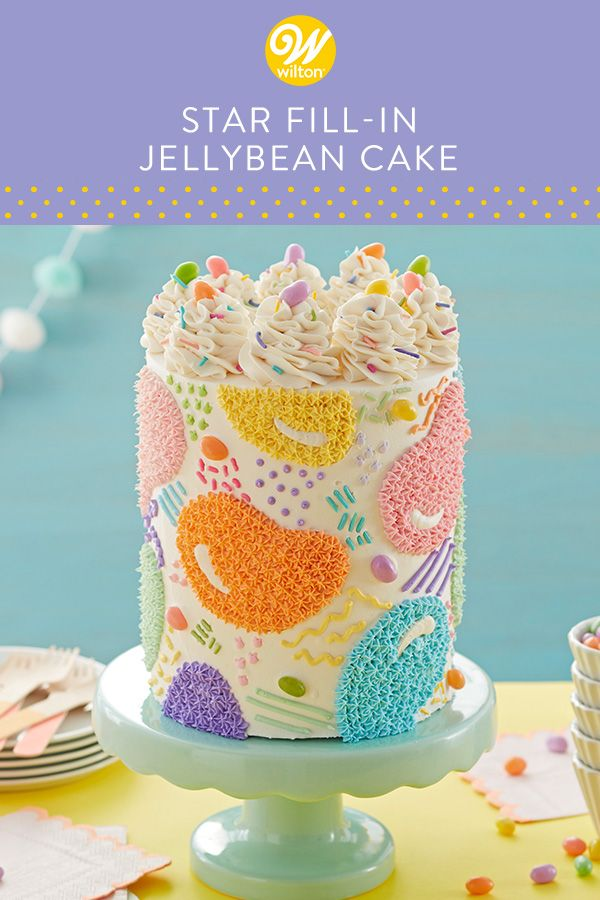 Use the star fill-in technique to make this fun and colorful jellybean cake. Outline your shapes using a cookie cutter, then simply color inside the lines with tinted icing. Top your cake with real jellybeans for the perfect finishing touch! A fun cake to make for any spring celebration, this jellybean cake is sure to satisfy everyone's sweet tooth! #wiltoncakes #easter #eastercake #jellybean #buttercreamcake #cakeideas #cakedecorating #spring #springcake #sprinkles #pipingitps #homemade #baking