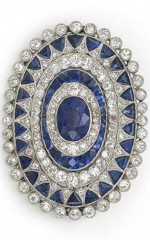 "An art deco sapphire and diamond brooch, circa 1925 centering an oval-shaped sapphire framed with several successive rows of old European and single-cut diamonds and calibré and triangular-cut sapphires; central sapphire weighing approximately: 2.50 carats; estimated total diamond weight: 2.60 carats; mounted in platinum. <a class=""pintag"" href=""/explore/diamondbrooches/"" title=""#diamondbrooches explore Pinterest"">#diamondbrooches</a><p><a href=""http://www.homeinteriordesign.org/2018/02/short-guide-to-interior-decoration.html"">Short guide to interior decoration</a></p>"