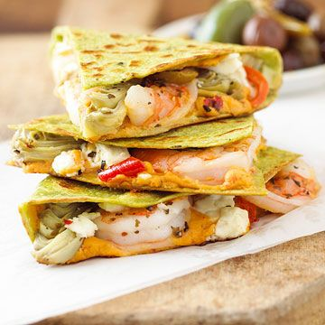 Shrimp Quesadillas with pepper hummus, artichoke hearts, shrimp and crumbled feta