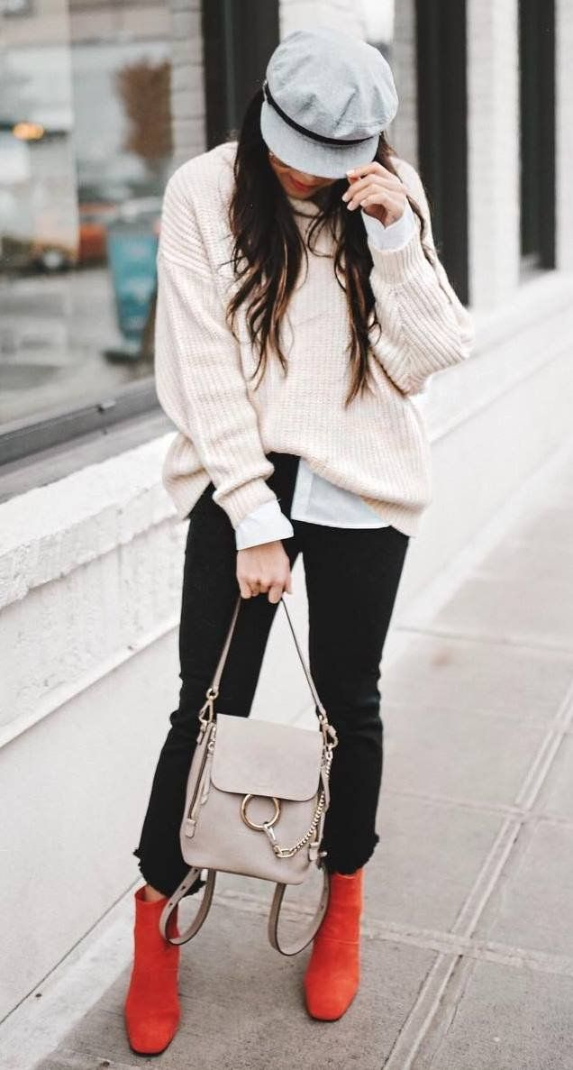 how to style red boots : hat white knit sweater black skinnies backpack