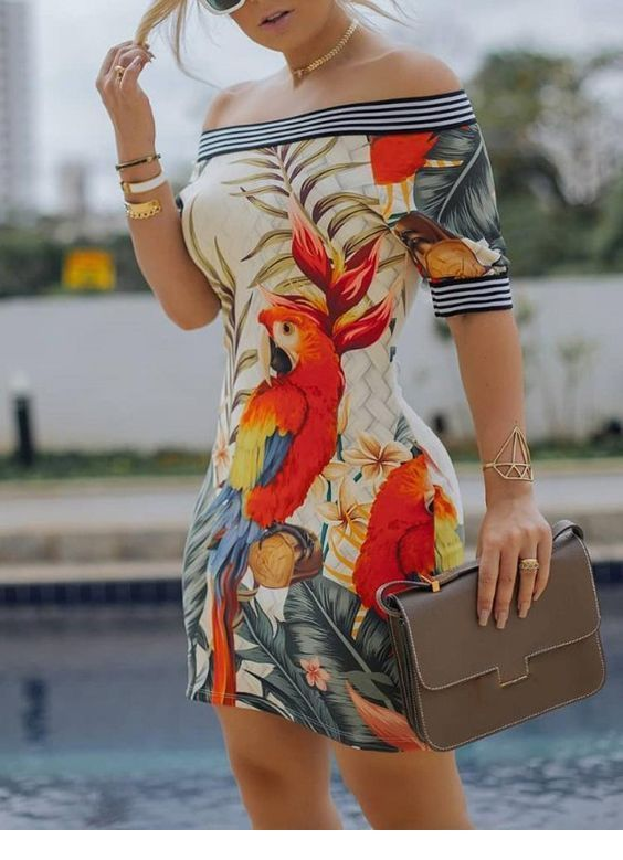 Amazing and colorful animal printed summer dress with a wonderful diamond gold bracelet