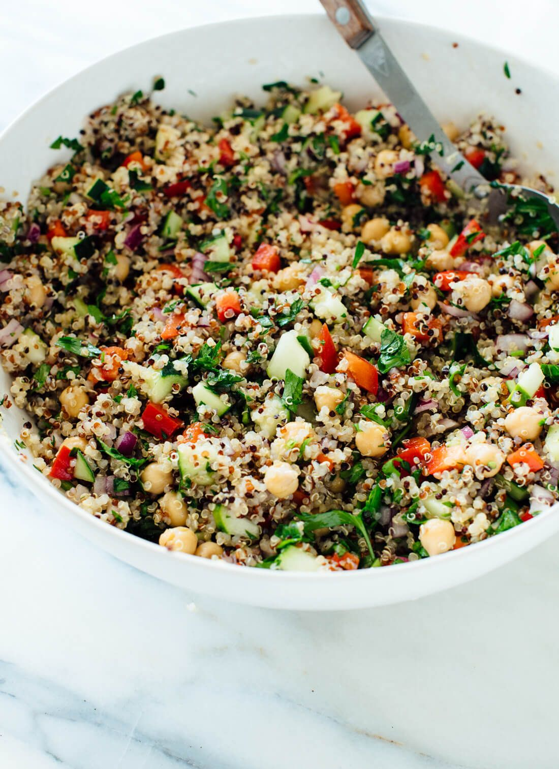 Salad made with quinoa, chickpeas, red bell pepper, cucumber, parsley and lemon.