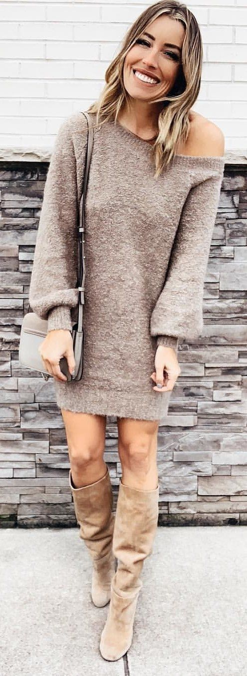 brown knit sweater dress and pair of brown suede boots