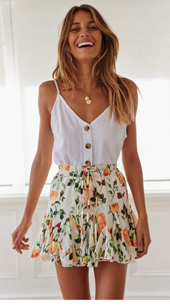 White top and floral mini skirt