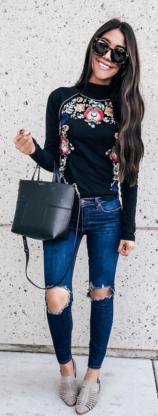 black floral long-sleeved top and distressed blue jeans