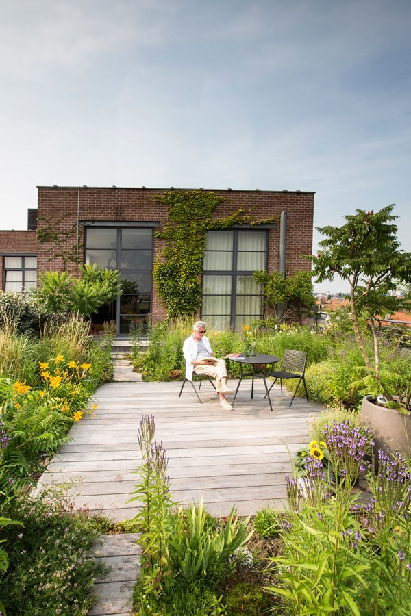 Leon is an outdoor person and quite fond of his amazing rooftop garden in Brussels, which he refers to as an important extension of his home. Round bistro table and side chairs from Tribù's Branch collection.
