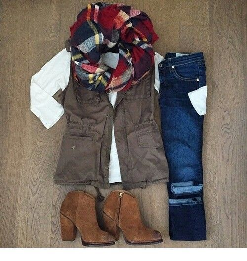 Brown boots, vest and scarf