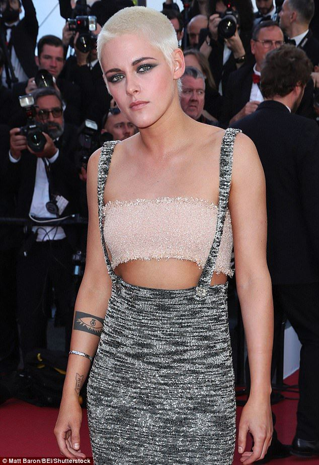 Ab-baring: Kristen Stewart, 25, looked sensational as she teased a look at her taut torso while stepping out at Cannes Film Festival on Saturday for the premiere of 120 Beats Per Minute