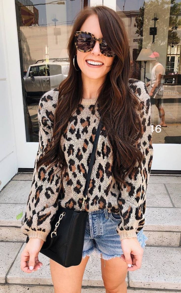 what to wear with a leopard sweater : black bag and denim shorts