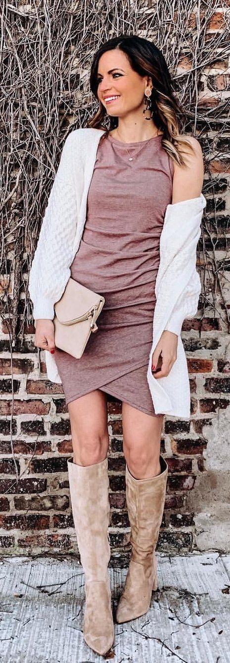 brown sleeveless dress, white cardigan, and pair of brown boots