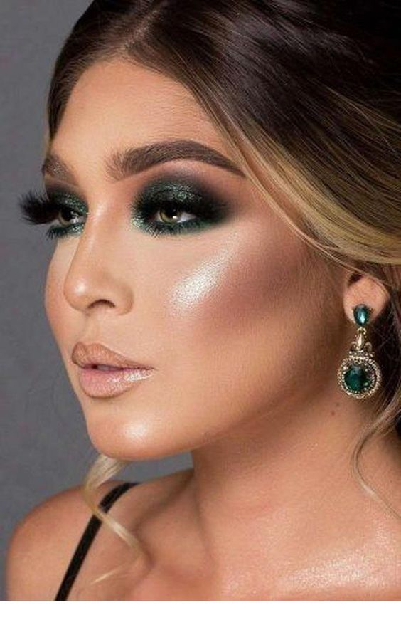 Glam green eye makeup and earrings