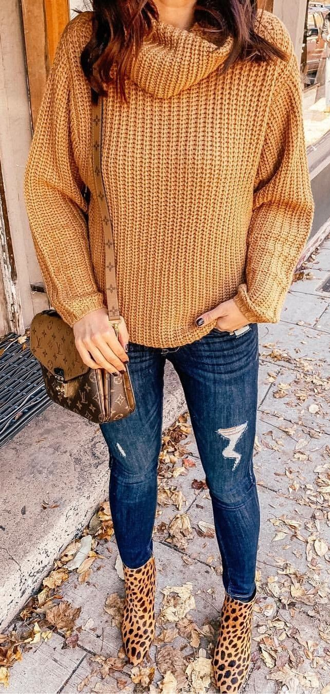 brown knit sweater and blue denim fitted jeans outfit