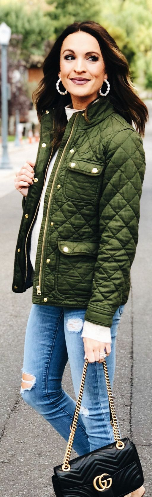 quilted green zip-up jacket
