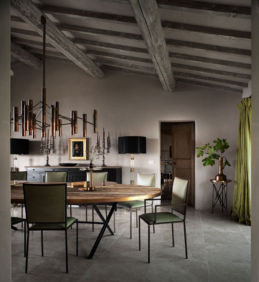 """B.B. for Reschio featuring """"The Oval Dining Table"""", """"The Simple Chair"""" and """"The Copper Tube Chandelier"""". Photo © Reschio estate."""