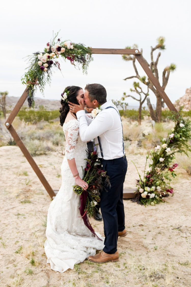 Joshua tree wedding with hexagon ceremony backdrop
