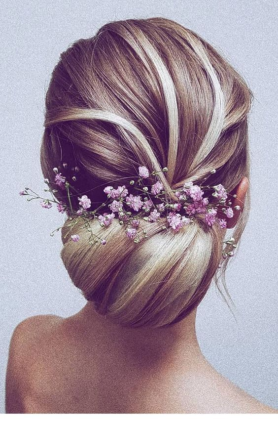 Romantic wedding bun with natural flowers