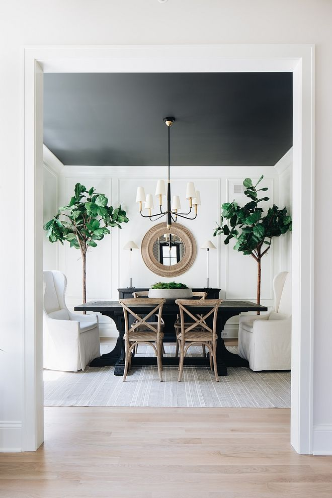 Black and white dining room This is one of my favorite dining rooms of all time. I love the simplicity of the color pallet - white, black, and wood; yet it is so far from simple Black and white dining room #Blackandwhite #diningroom #colorpalette