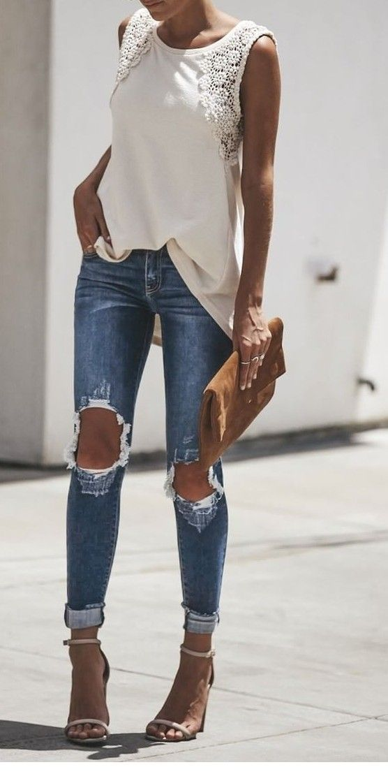 Nice white top, blue jeans and brown bag