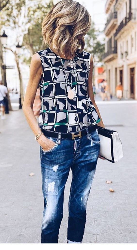 Printed top and blue jeans with many accessories