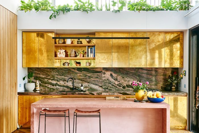 wowza!!! these metallic gold cabinets are incredible.