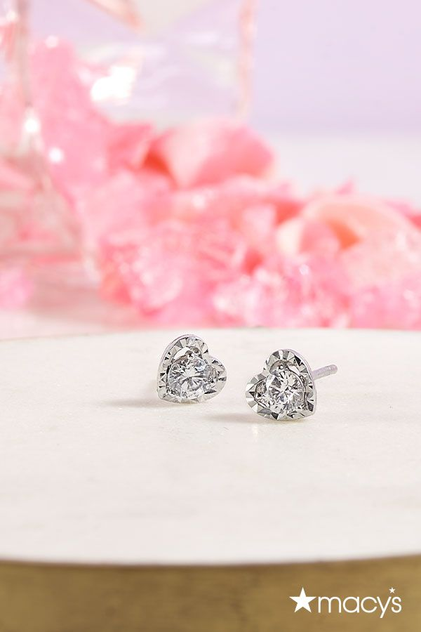 This Valentine's Day, show them how much you care with a little heart to heart. These diamond stud heart earrings from Macy's are an elegant accent that never goes out of style. | From loved ones to your best galentines, find the gift you'll love to give as much as they'll love to get at macys.com