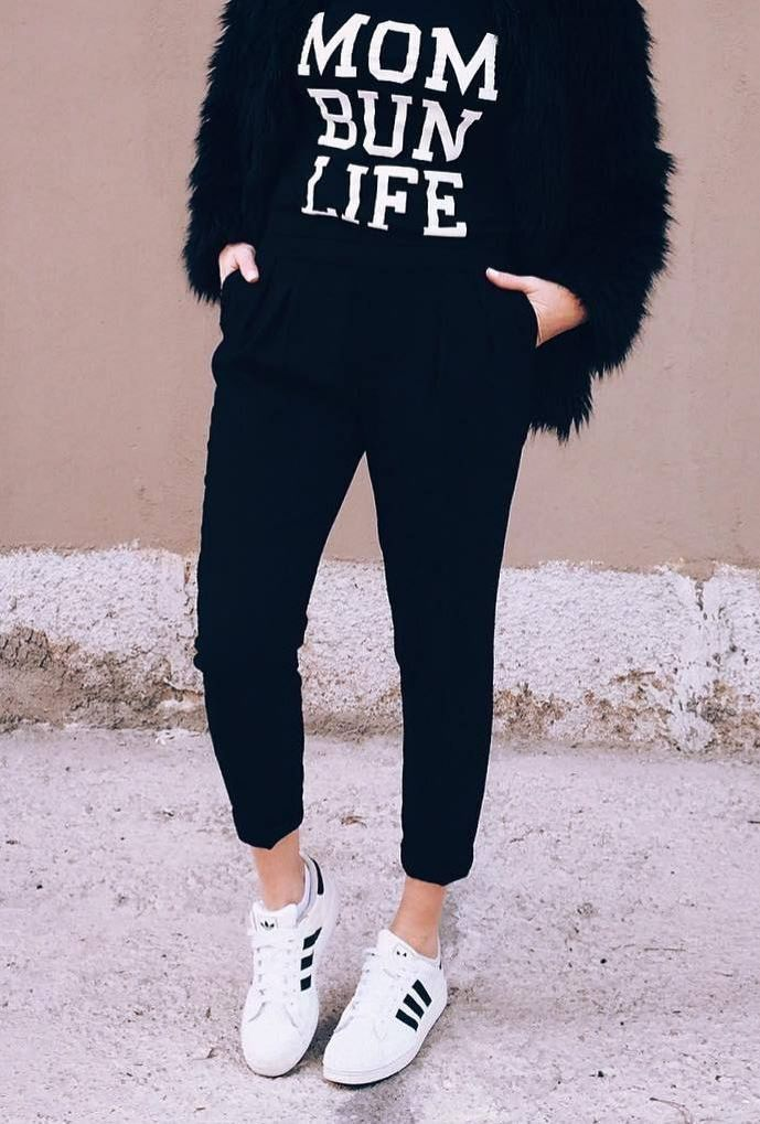how to style a pair of white sneakers : fur jacket + printed top + black pants