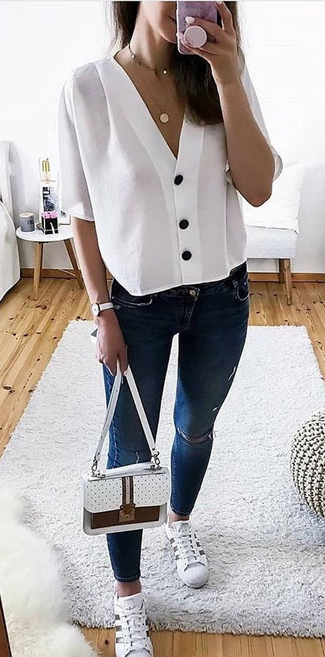 mirror selfie of a woman in a white top #summer #outfits