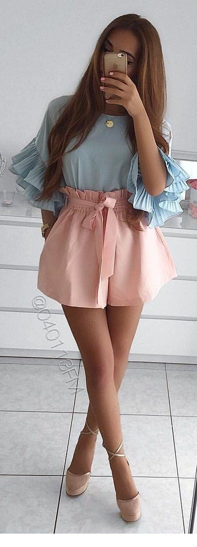 Blue blouse and beige shorts